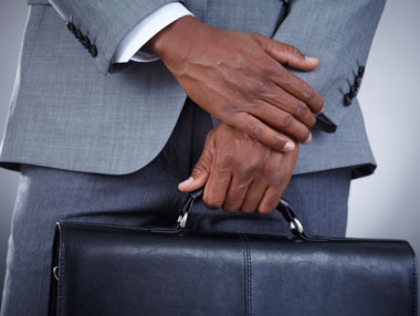 Man in Suit Holding a Briefcase
